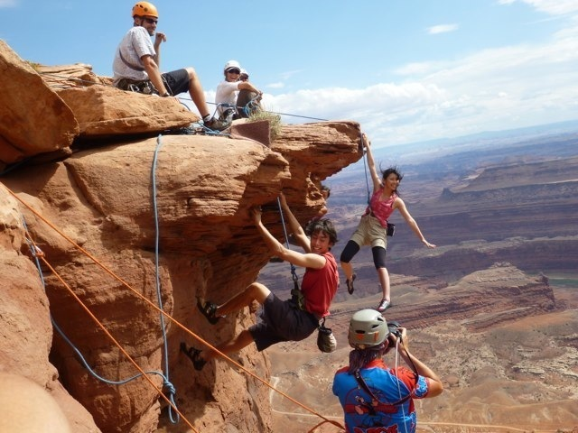 Climbers free soloing over Dead Horse Point, yeehaw!